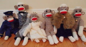 Sock monkeys Captain Eugene, Sir Rudyard, Miss Beatrice, Ebenezer the Lighthouse Keeper, Dame Lorraine, and Throckmorton