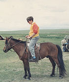 Pat Schaffer riding a horse in Mongolia