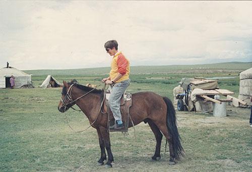 Pat Schaffer riding a horse in Mongolia