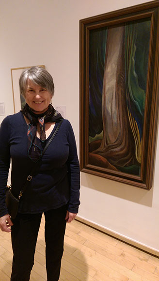 Eileen standing next to Tree Trunk, 1931, oil on canvas, at Vancouver Art Gallery
